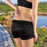 Back pain woman. Royalty Free Stock Photos
