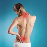 Back pain. Woman suffering from lumbago or back pain. Young Caucasian female with osteoporosis indicated by red spots Royalty Free Stock Image