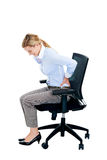Back pain woman. Back tension pain from office chair posture isolated on white background royalty free stock image