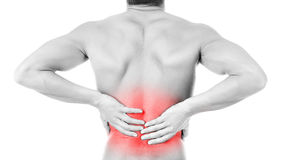 Back pain. Young man with back pain isolated in white royalty free stock photography