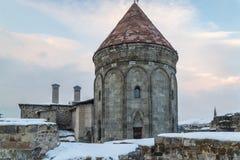 Back part of Cifte minareli medres double minarets old school in Erzurum, Turkey. In winter royalty free stock photo