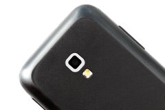 Back part of the smart phone with the chamber on a white backgro. The main object is the camera of the smartphone royalty free stock photos