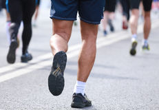 Back of people legs running calves Stock Photos