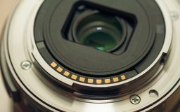 Back of photo lens bayonet with golden contacts. Back of a photo lens bayonet with golden contacts stock photo
