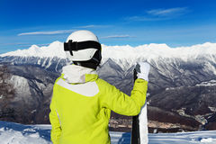 Back photo of woman with ski look at valley Stock Images