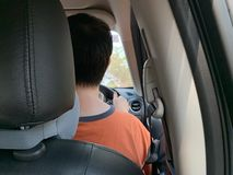 The back photos of men driving inside the car royalty free stock photography