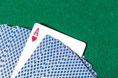 Back of the playing cards and ace of hearts Stock Image