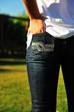 Back Pocket. The backside of a girl wearing jeans with her hand in her pocket Royalty Free Stock Images