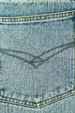 Back pocket of blue jeans, denim texture background. Royalty Free Stock Image