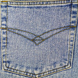 Back pocket of blue jeans, denim texture background. Stock Photo