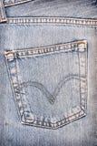 Back pocket of blue jeans Stock Photo