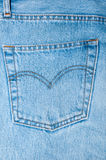 Back pocket on the blue jeans trousers Stock Image
