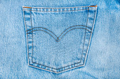 Back pocket on the blue jeans trousers Royalty Free Stock Photos