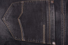 Back pocket of dark jeans close up Stock Photos