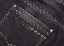 Back pocket of dark jeans close up Royalty Free Stock Photo