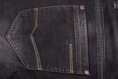 Back pocket of dark jeans close up Stock Image