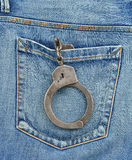 Back pocket of jeans with handcuffs Stock Images