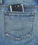 Back pocket of jeans mobile phone Royalty Free Stock Photo