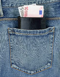 Back pocket of jeans with wallet and euro banknotes. Back pocket of jeans and wallet with euro banknotes Stock Photo