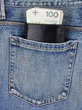 Back pocket of jeans with wallet and money Royalty Free Stock Photos