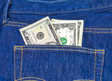 Back pocket with money blue jeans Royalty Free Stock Images