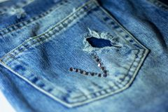 Back pocket of my jeans with applique strass in the form of hew V Stock Photos