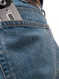 Back Pocket Series - Cel. A closeup of a cellular phone in the back pocket of blue jeans, isolated on white Stock Image