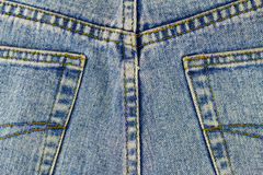 Back pockets of blue jeans, denim texture background. Royalty Free Stock Photos