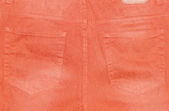 Back pockets of orange trousers royalty free stock images