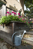 Back porch with watering can Royalty Free Stock Photo