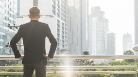 The back portrait silhouette smart business man stands with conf Royalty Free Stock Photography