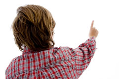Back pose of boy pointing Stock Photo