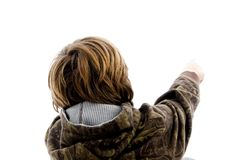 Back pose of boy pointing Stock Image