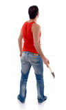 Back pose of man with hammer Royalty Free Stock Images