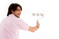 Back pose of man with paint roller Stock Photos