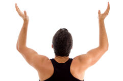 Back pose of man with raised arms Stock Photo