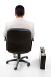 Back pose of manager sitting on chair Stock Photos