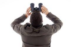 Back Pose Of Man Using A Pair Of Binoculars Stock Image
