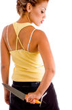 Back Pose Of Young Woman With Knife Royalty Free Stock Images
