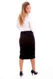 Back pose of standing manager looking at camera Royalty Free Stock Image