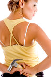 Back pose of woman holding hammer Royalty Free Stock Photography