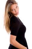 Back pose of woman looking at camera Stock Photo