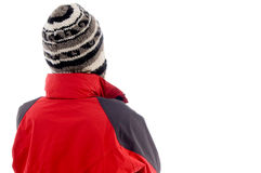 Back pose of young guy in winter cap Stock Photos