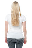 Back pose of a young woman in casuals Royalty Free Stock Image