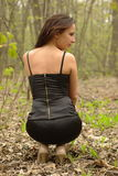 Back of pretty girl in a black dress Royalty Free Stock Photos