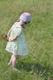 Back of pretty little girl in dress with windmill Royalty Free Stock Photos