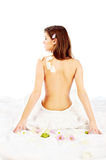 Back of pretty spa woman. Back of beautiful brunette woman, isolated on white Stock Images