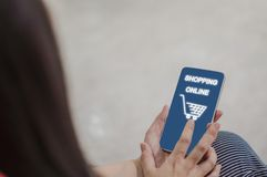 Back rear view-close up of women holding smartphones for online shopping, concept buying products from shops with convenience and royalty free stock image