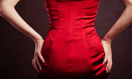 Back in red silk dress on dark background Royalty Free Stock Photo