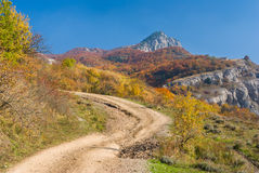 Back road in autumnal mountains Royalty Free Stock Photos